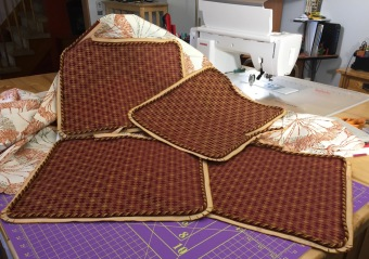 Photo of cushion cover pieces with glue basted cording.